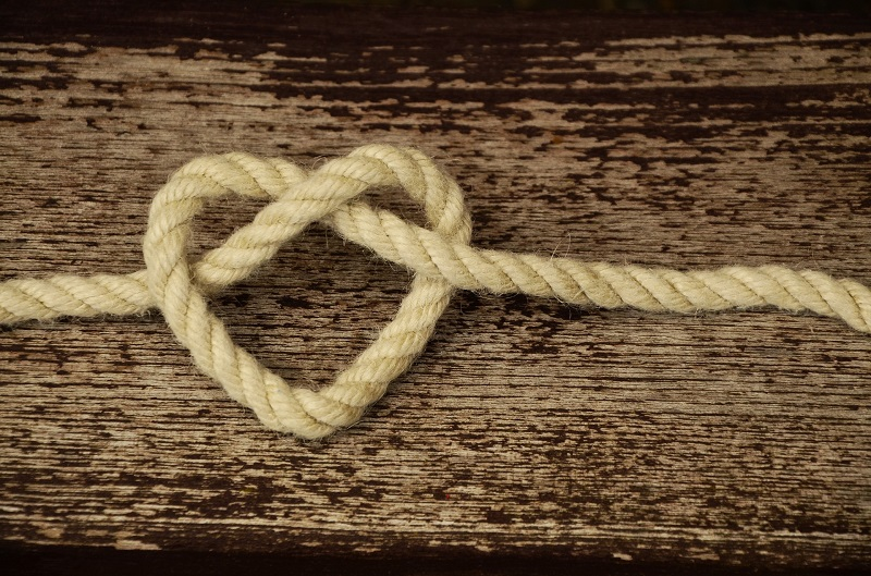 Tips For Lowering Cholesterol Naturally a Rope In the Shape of a Heart