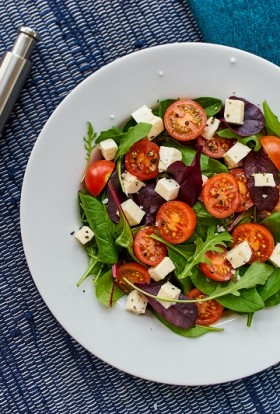 Refreshing Salad Recipes A Bowl of Salad Sitting on a Table with Salt and Pepper Shakers