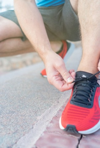 10 Minute Workouts Man Tying His Running Shoes