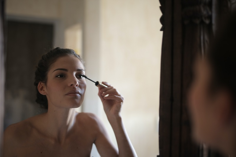 Benefits of Aloe in your Beauty Routine Woman Applying Mascara in the Mirror