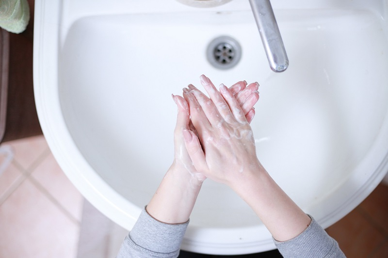 Herbal Aloe Bath & Body Care Products Person Washing Their Hands
