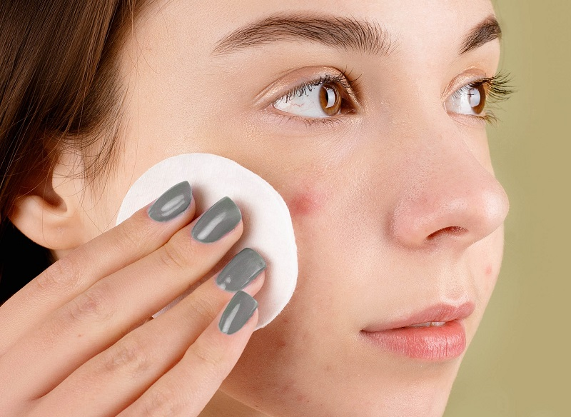 Herbalife Skin Products for Acne Woman Putting Cream on Her Face