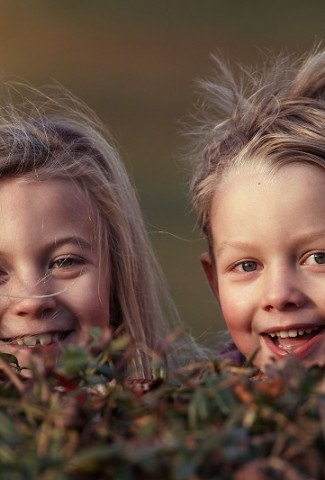 Herbalife Children's Health Product Benefits Two Kids Hiding Behind a Bush Playing