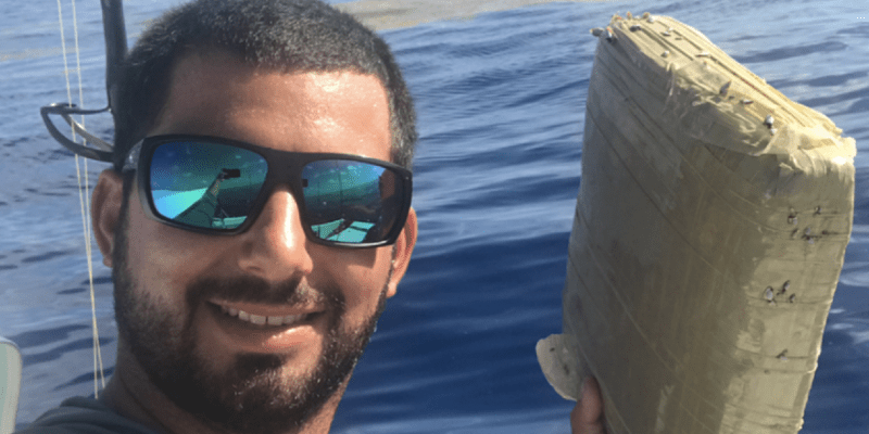 Fisherman-Jorge-Bustamante-reels-in-brick-of-cannabis