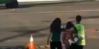 woman tried it chase down a moving plane after she missed it in bali