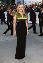 Kate Winslet appeared in pure Gold at the Toronto Film Festival