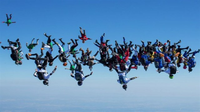 Watch 57 skydivers - Party flying through the sky
