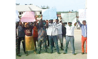 Save us from land grabbers, community begs Ambode