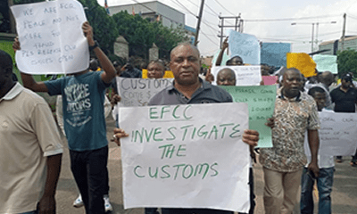 Car dealers lay siege at Customs office, protest sealing of businesses