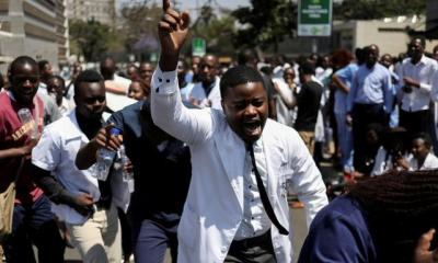 Zimbabwe fires 211 striking doctors as economy worsens