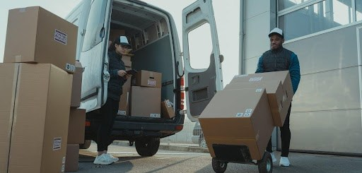 https://www.pexels.com/photo/a-man-and-a-woman-working-for-a-delivery-company-6169668/