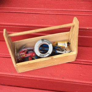 Hand-made small wooden toolbox filled with  hand tools