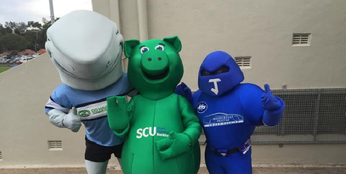 The Jets might have lost to the Mounties but there was excellent team-work between these three mascots at Henson Park on Saturday – (From left to right): Reefy the Shark (Cronulla-Sutherland RLFC), Syd the Pig (SCU – More Generous Banking) and the Jetman (Newtown RLFC). Photo: Sara Leonard