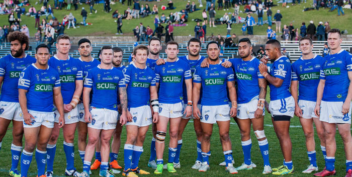 Kurt Kara and most of his Newtown Jets team-mates at the completion of his 100th NSW Cup match with Newtown RLFC.  Photo by Mario Facchini Photography