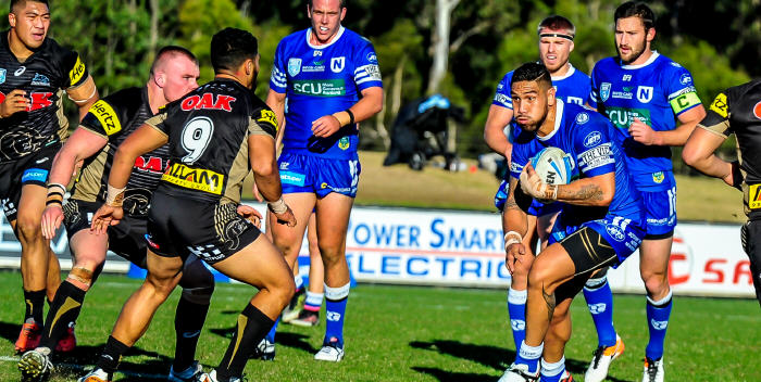 Newtown Jets front-rower Jesse Sene-Lefao confronts the Penrith Panthers defensive line last Saturday, backed up by (from left) Harrison Muller, Matt McIlwrick and Mitch Brown. Photo: Gary Sutherland Photography