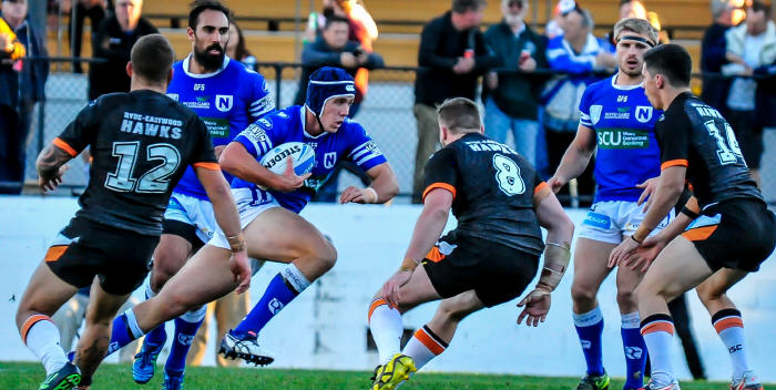 Young Newtown Jets front-rower Harrison Muller charges into the Wests Tigers defence at Leichhardt Oval on Saturday, with his team-mates Travis Robinson (left) and Matt McIlwrick close by. Photo: Gary Sutherland Photography.
