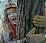 Melissa McCarthy hugging tree
