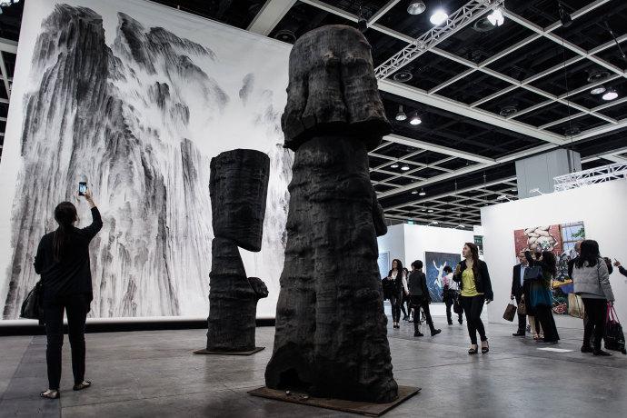 Paintings by Xu Longsen and sculptures by Wang Keping, at Art Basel in Hong Kong.