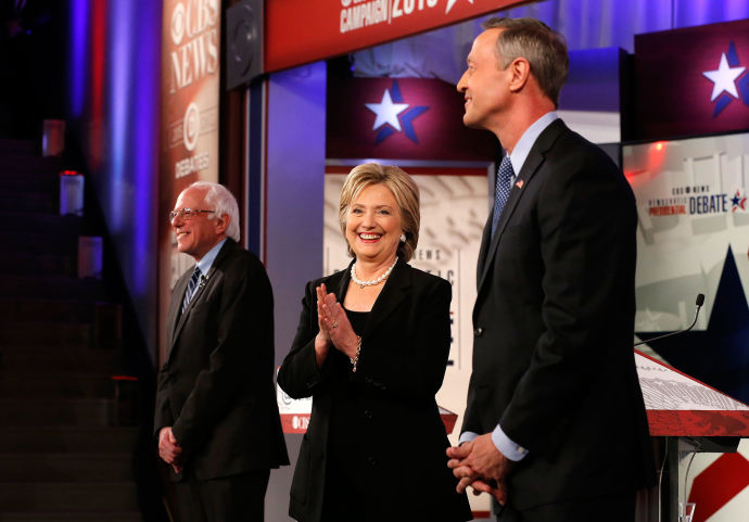 Bernie Sanders, Hillary Clinton, and Martin O'Malley onstage Saturday, in Des Moines, Iowa.