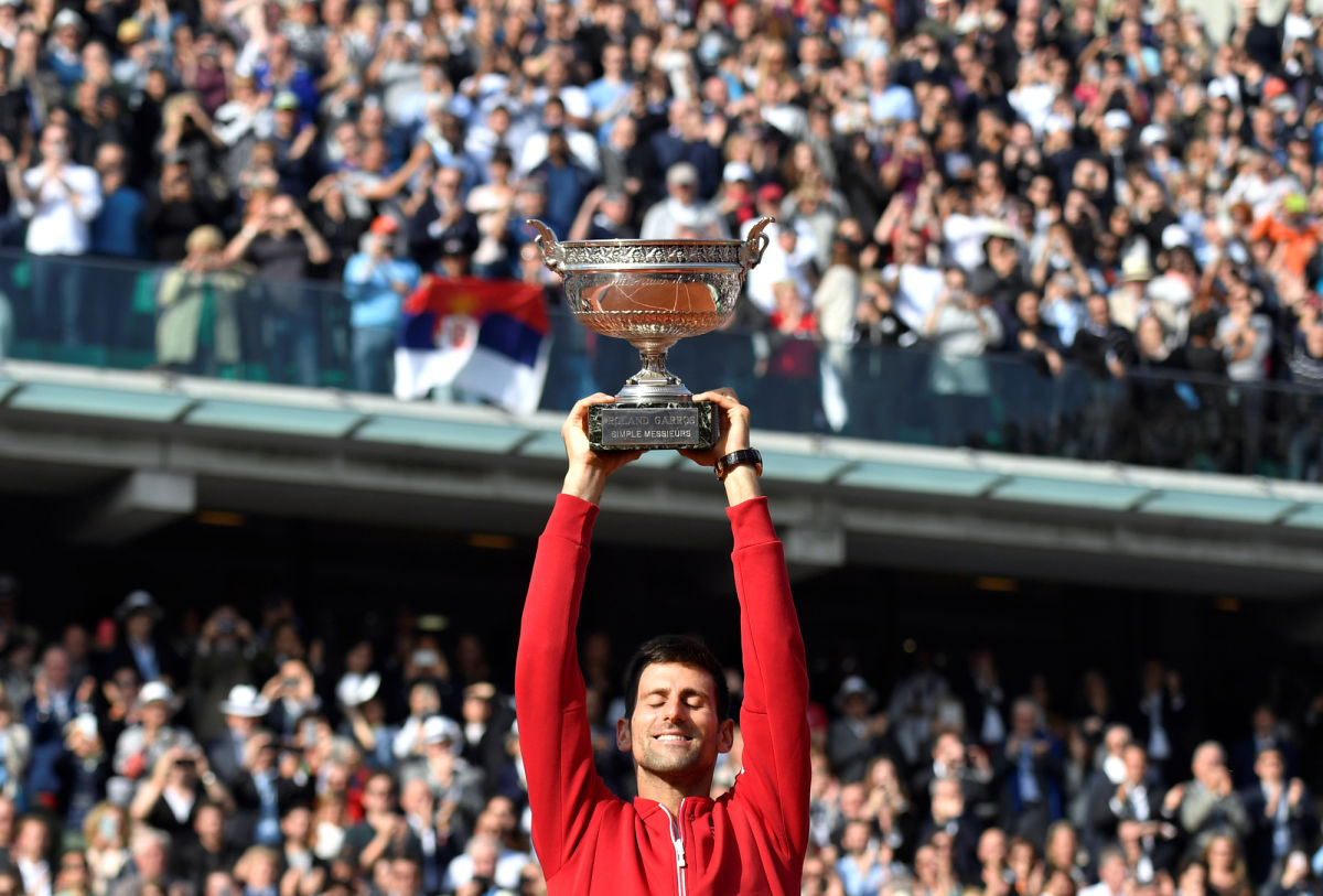 A blissful Novak Djokovic's finally lifts the winners' trophy at Roland Garros