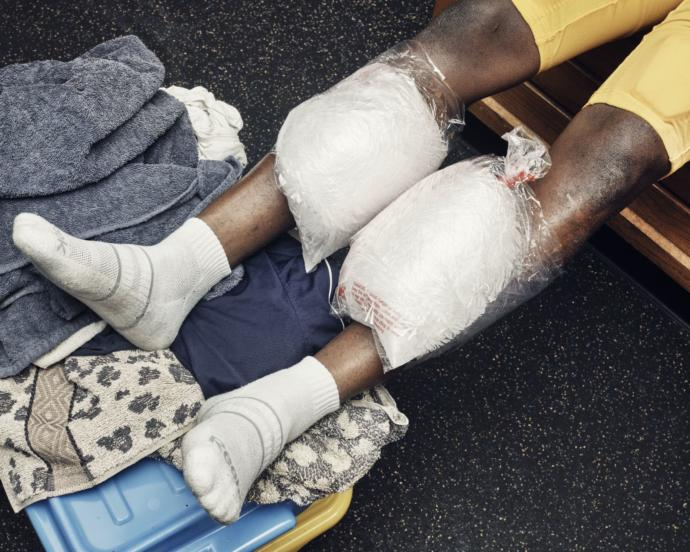 "A player ices his shins after a game. Before one kickoff, Harriott offered the team some final words: ""Leave a mark forever on this field. The St. Thomas spirit should never leave here. They should never, ever want to see blue-and-gold again."""