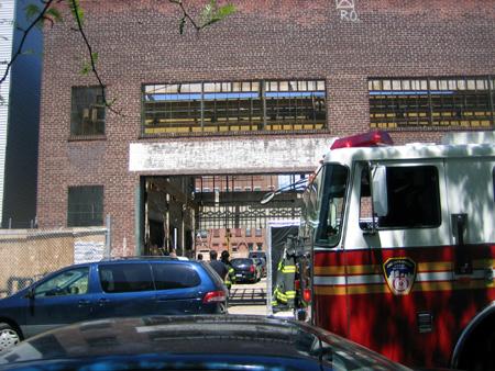 Firemen inspecting 110 Green Street site