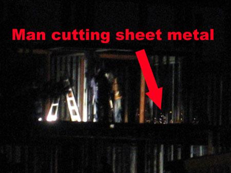 Man cutting sheet metal, 143 Huron 10/16/07