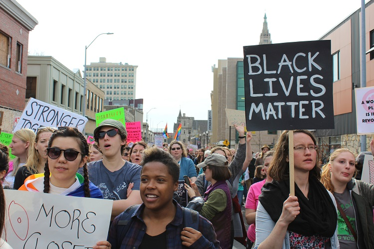 Our Feminism Must Be Intersectional march through East Liberty. Photo by Amanda Waltz.