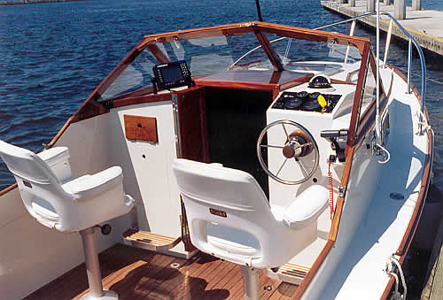 20  Coho  Interior photos of custom wooden boats Here we are in the cockpit of Ceilidh  She has the stock white bucket  chairs  teak sole  and optional consoles aft of the cabin bulkhead