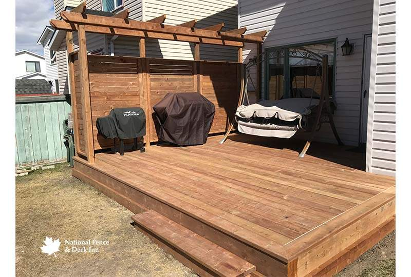 Pressure Treated Deck With A Pergola Structure