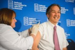 Howard K. Koh, MD, Assistant Secretary of Health, receives his annual flu vaccine