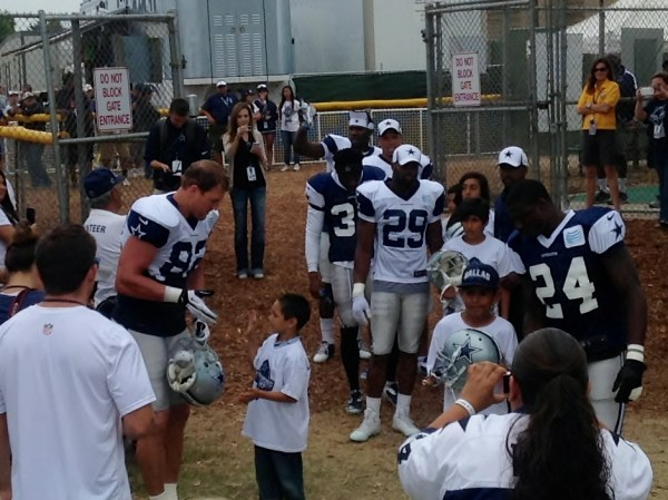 Players walk out with kids