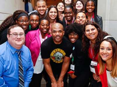 Students Pose for a Photo with Rapper DMC for Shadow Day in Washington DC