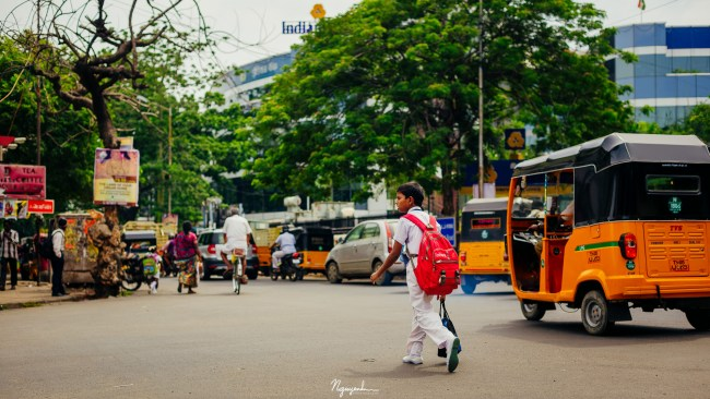 Schoolboy at an intersection
