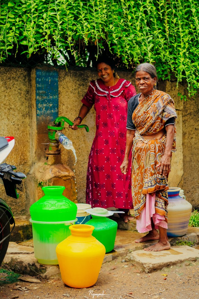 At a water well, these two ladies are pumping water for their families. Most of the ground water supply in Chennai is not truly fresh. There is a salt intrusion to make the ground water a little salty.