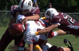 Goffstown's Tim Comeau, left, and Damian Jackson team up on a sack of Concord's Jake Lewis.
