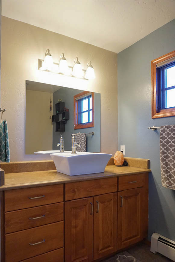 2575 Young Court's master bath vanity has a vessel sink