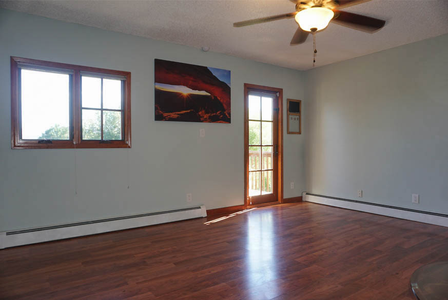 Family room has access to back deck & pergola at 2575 Young Court