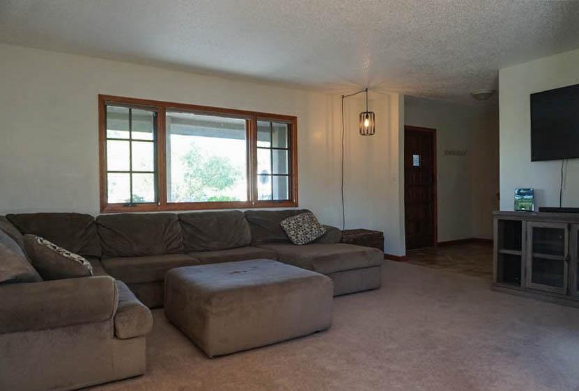 Living room has large north-facing windows