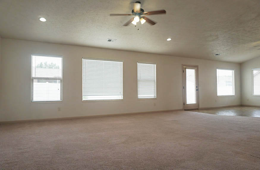 The large family room stretches across the back of the home