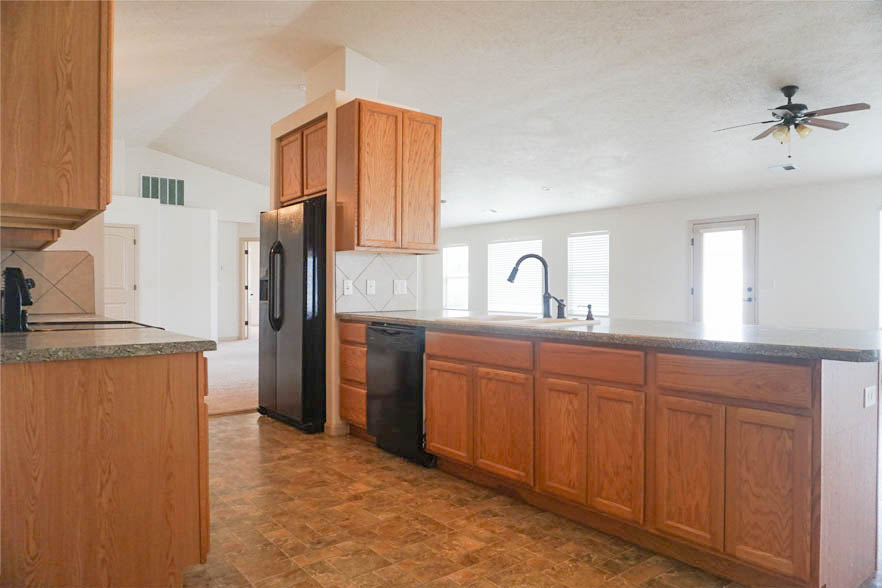 The kitchen is open to the dining & family rooms.