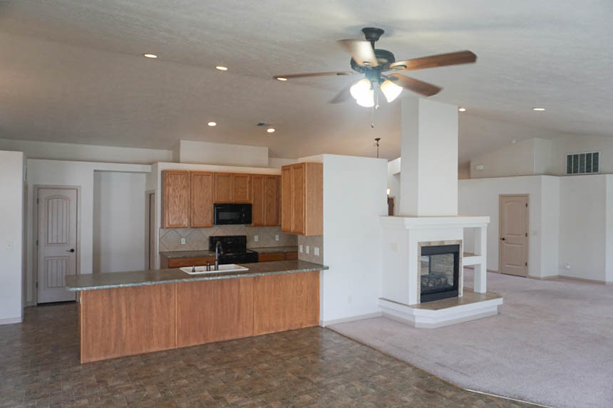The kitchen includes all appliances, a breakfast bar, and a pantry.
