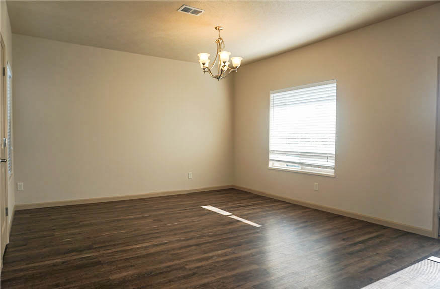 Dining room has a large window, access to the back patio, and access to the walk-in pantry.