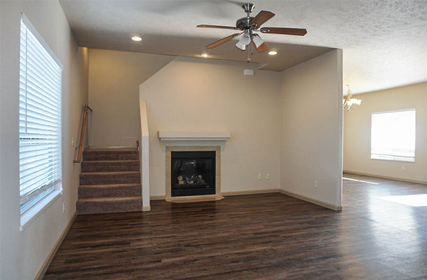 Gas fireplace and lighted ceiling fan in the living rom of 190 Winter Hawk Drive