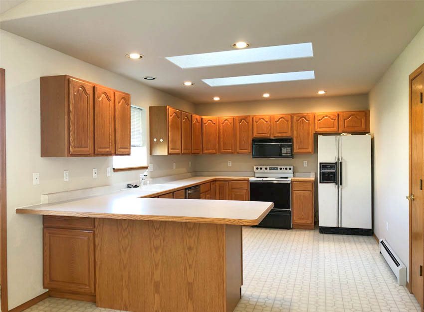 Large kitchen with skylights & plant window!