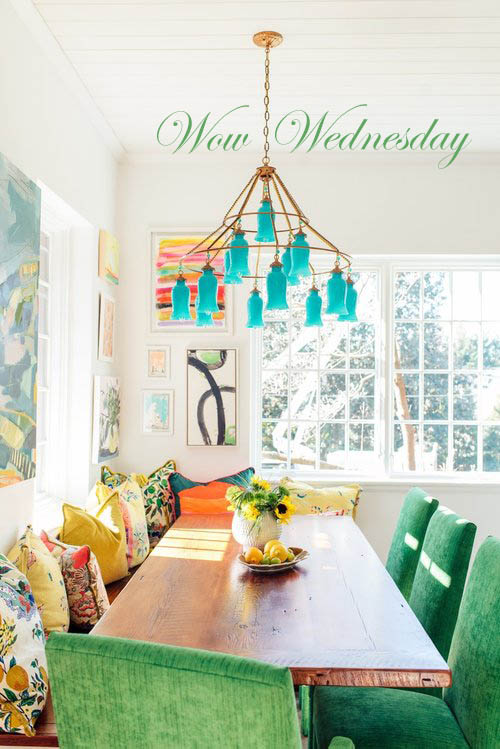 Wow Wednesday! Bold dining room with a teal art glass chandelier and bright pops of color.
