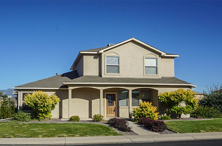 2995 Golden Hawk is a 4 bedroom, 2.5 bath home in Hawks Nest with a 3-car garage and large RV parking area. THe master is on the main level, with 3 bedrooms, a full bath with 2 vanities, and family room upstairs.