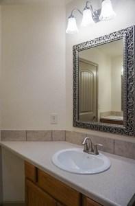 The upstairs full bath in 2995 Golden Hawk has double storage vanites