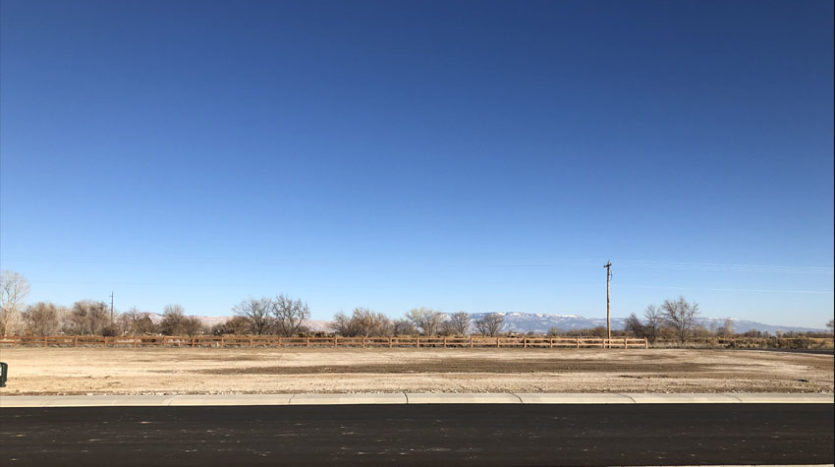 1224 Adobe Falls Way is a vacant lot in Fruita with views of the Grand Mesa, Bookcliffs, and Colorado National Monument.