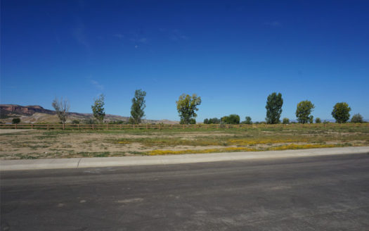 Looking north-west across 1325 Fairway Drive, a vacant lot in Fruita, CO.